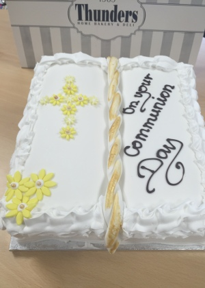 Sponge cake filled with buttercream and finished with icing, Flower cross and gold trim