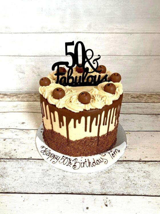 50 and fabulous caramel drip cake